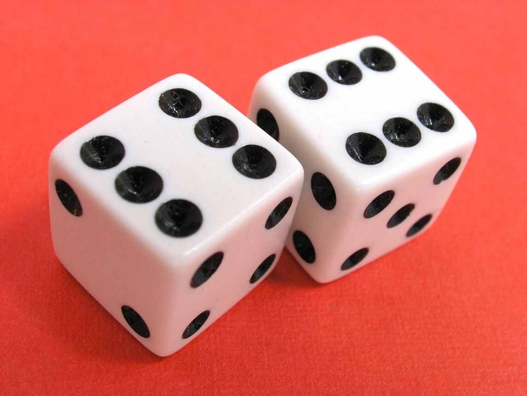 pair of dice, used for gambling at a casino, usually at craps table
